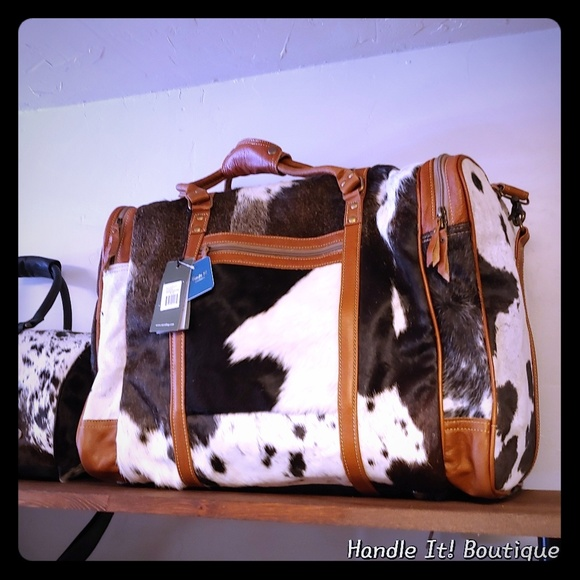 Myra Bag Bags Myra Bag Grand Duffle Duffel Cowhide Unisex New Poshmark Shop the new duffle bags collection, handpicked and curated by expert stylists on poshmark. myra bag grand duffle duffel cowhide unisex new